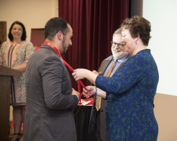 The 看护 Program's inaugural pinning ceremony took place during Commencement Weekend 2019.