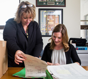 A Carthage student works with her supervisor at an internship at the courthouse.