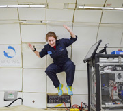 A student conducts research aboard NASA's zero-gravity aircraft.