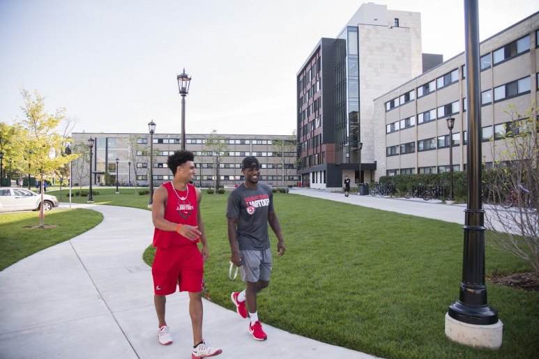 Students chat as they walk around campus.