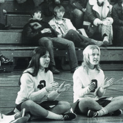 A vintage photo of cheerleaders cheering on the Red Men.