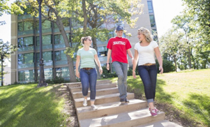 This photo, showing students walking down stairs near the Oaks Residential Village, invites stude...