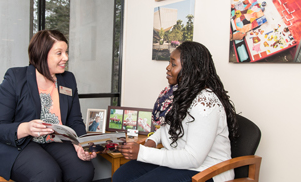This photo, showing a prospective student visiting with an admissions representative, invites stu...