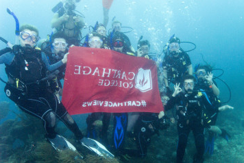 Students scuba diving in Honduras
