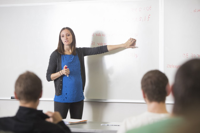 Prof. Sara Jensen teaches calculus to her students.